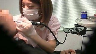 Asian nurse pleases a patient by jerking his stiff pecker